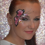 Kiss My Fairy chunky glitter eye and butterfly face paint design
