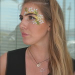 Kiss My Fairy chunky glitter eye and flower face paint design