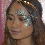 Kiss My Fairy chunky glitter eye and feather face paint design