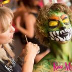 Kiss My Fairy staff hand painting male client as a green monster